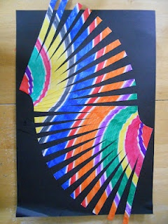 Movement With Lines. Color diagonal lines with markers.  On the back, draw half inch vertical strips, cut strips, arrange strips on black paper to show movement.