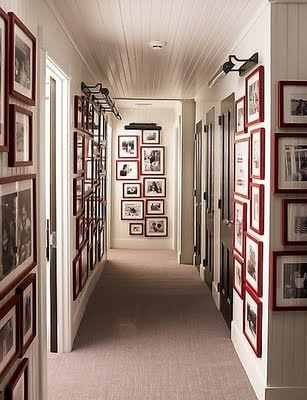 Upstairs hallway - walls covered with red frames and picture lighting - Steven GambrelWall Art, Elle Decor, Hallways, Black And White, Gallery Walls, Red Frames, Frames Wall, Pictures Frames, White Wall
