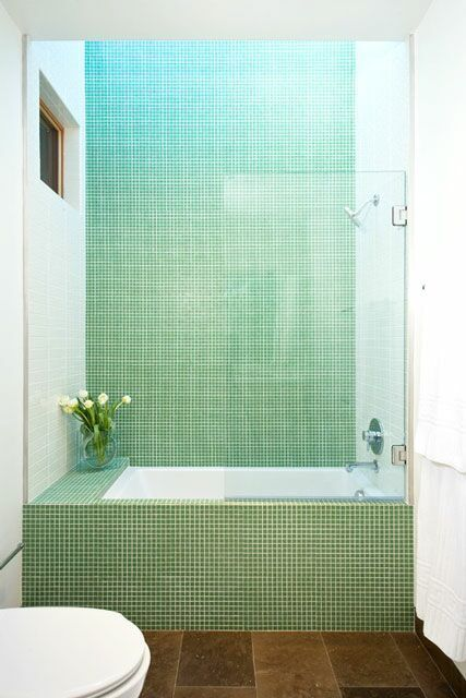 9 Seriously Fabulous Bathrooms  #refinery29  http://www.refinery29.com/living-in-a-shoebox/12#slide-5  San Francisco firm Swatt | Miers Architects is the mastermind behind this stunning tub-shower combo. The stunning tiles are from Cartglass. And, we think fresh flowers absolutely have a rightful place in the powder room. Can you imagine soaking in this beauty?