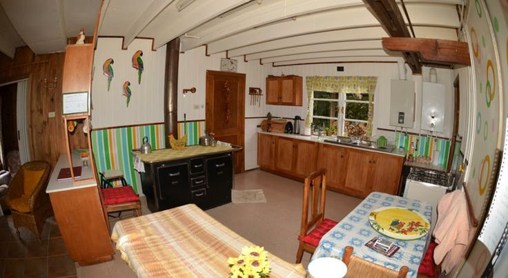 Spacious kitchen with wood-fired stove. http://hostallagringacarioca.cl/