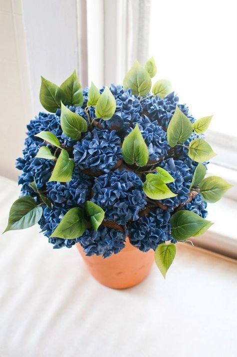 I've seen a few Cupcake Bouquet tutorials on Pinterest and, although this is not a tutorial, just a picture, this is mine that I did. I combined two pins - the bouquet idea and a pin I made from a hydrangea tutorial I found online. (Chocolate Buttercream Flowers)