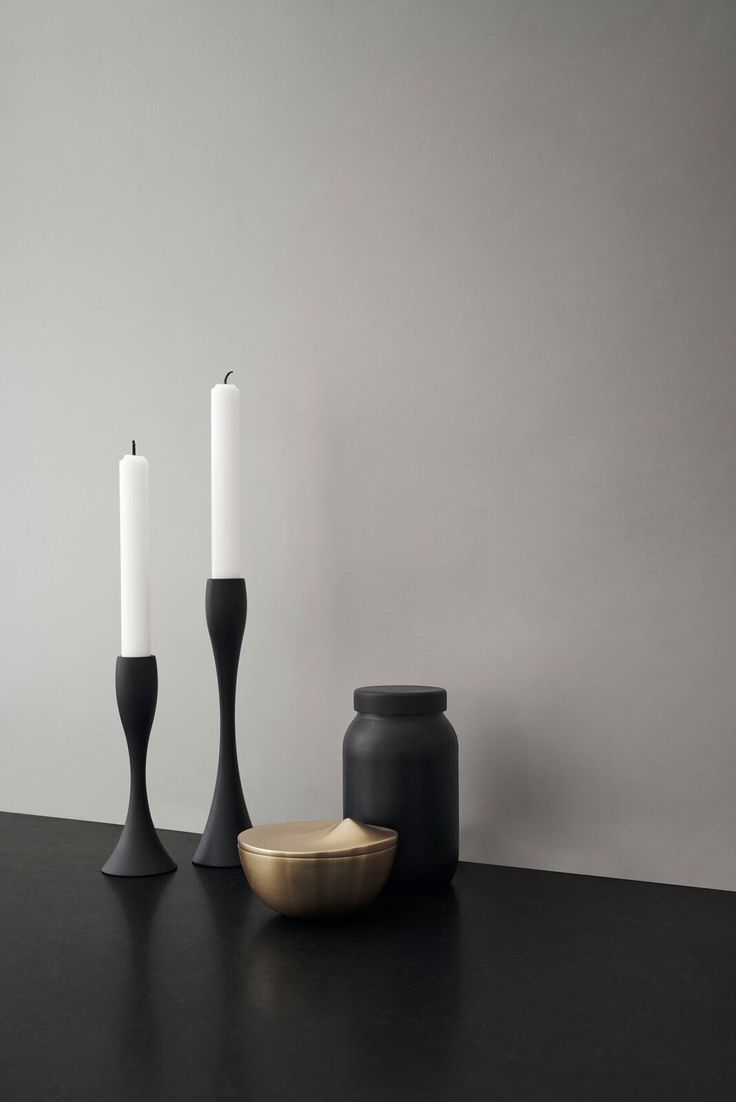 Light a candle The slender, organic and feminine candlesticks are designed by the Danish architect duo Halskov & Dalsgaard. The candlesticks are available in two heights. The heights of the candlesticks are complementary, creating a beautiful sea of light when clustered together.