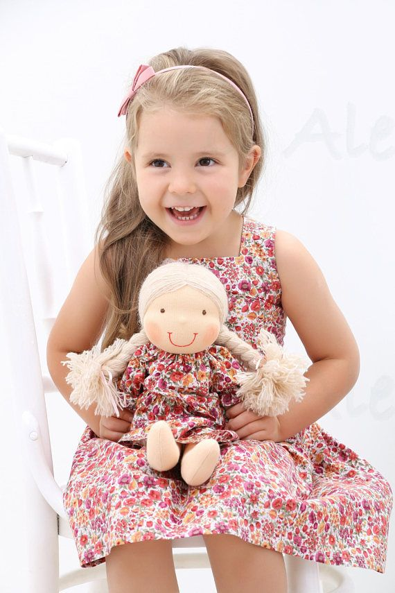 Matching doll and girl dress including handmade Waldorf doll