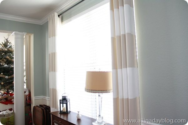 Tan and white striped curtains...paint horizontal white stripes on tan curtains (from Ikea)