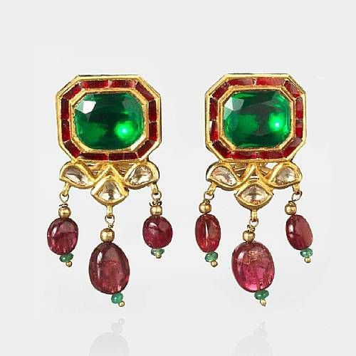 Octagonal form set with an emerald, rubies and diamonds, with red bead pendants. From India, 20th Century.