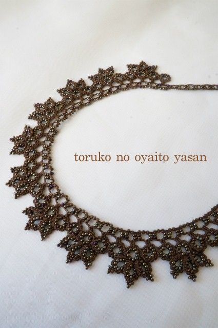The bird's eye motif attached to a chain and then embellished with leaves. lovely!
