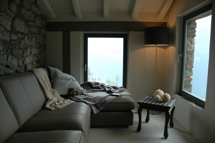 Comfortable leather sofas with uninterrupted views across the lake