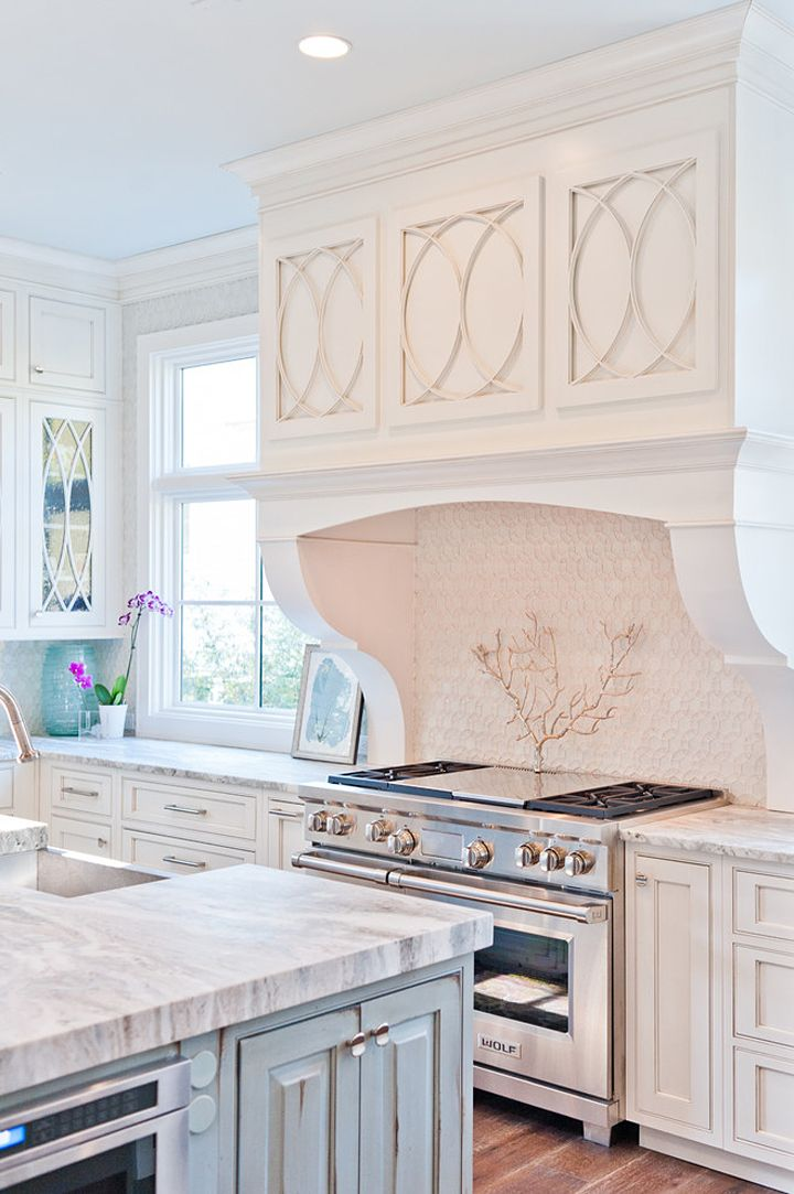 Coastal inspired kitchen with sculpted cabinets