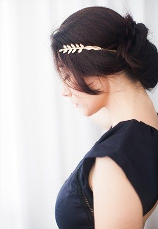 This exquisite Greek goddess headband is what you've been waiting for all your life, even if you didn't know it. It's promised to get you into a fantasy dreamy mood. It's guaranteed to bring out the goddess in you, and by putting it on- turning you officially into a goddess.  The headband includes two large greek style leaves and two small leaves, a couple on each side, all 24 karat matte gold pleated. It's worn from the back of the head. By twisting strands of hair around the metal you can…