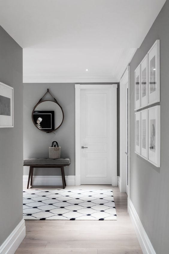 Interiors Update: Shark Skin Grey. I love grey walls and neutrals and this paint colour is classic and stunning. It looks beautiful against the white frames of the picture frames and the black and white tiles floor.