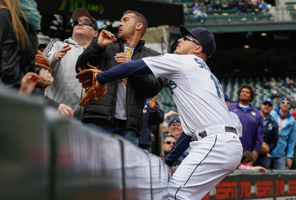 Third baseman Kyle Seager #15 of the Seattle Mariners chases a pop foul off the bat of Alex Presley of the Houston Astros into the stands in...