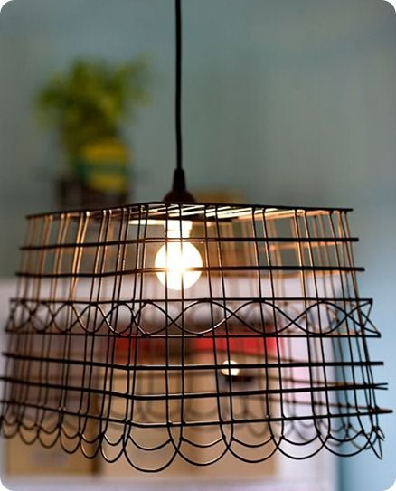 Pendant Light made out of a wire basket from Knock Off Decor. Very cool.