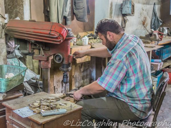 Man working in workshop in the Buyuk Valide Han, Istanbul, Turkey