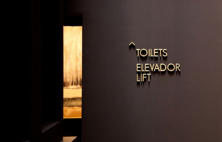 The Longroiva Hotel & Termal Spa is an architectural project by RA\\ STUDIO in the north of Portugal. We were comissioned to design the hotel´s signage. We created a signage system and a communication strategy that could reflect the architectural identity of the hotel. The solution in brass reflected the solid and classical energy of the place.  //graphic design, signage
