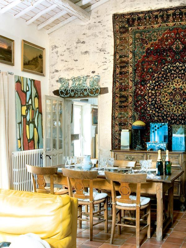 Love the enormous rug, hung on the wall like a tapestry.