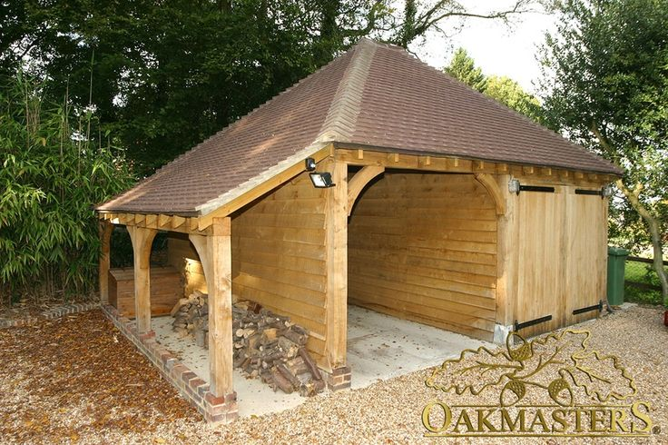 Two bay semi closed oak framed garage with log store