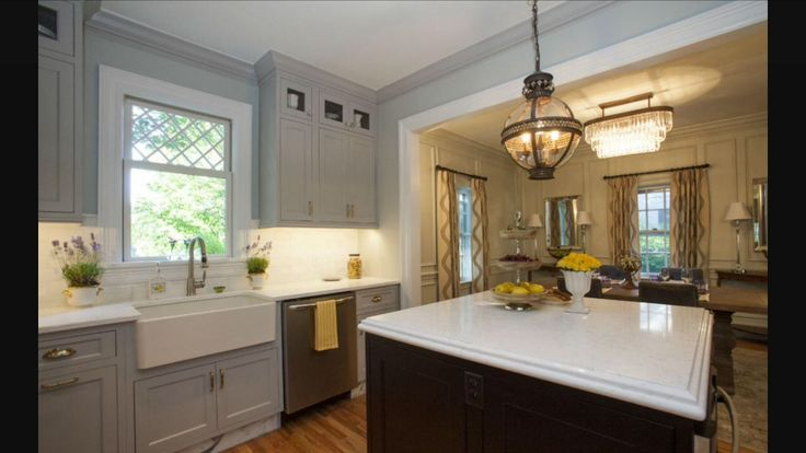 Farmhouse kitchen sink and beautiful grey kitchen cabinets make a beautiful combination! From: Property Brothers kitchen by Jonathan, 100th episode