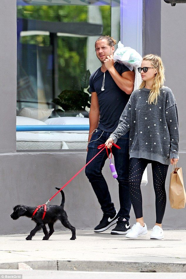 Puppy love: Margot Robbie and her husband Tom Ackerley were seen taking their adorable rescue puppy Boo Radley for a walk around Los Angeles on Thursday