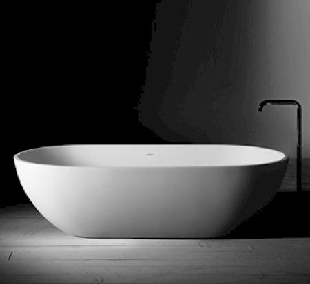 The Vogue stone bath combines elegance and style. Beautiful shape and natural curves will make this bath the centre piece of the designer bathroom. This bath was designed to complement the Vogue stone basinDimensions: 1700mm x 850mm x 500mmWeight: 166kgPlatine stone baths are made from 50% Refined Scandinavian Limestone and 50% High Grade Resin. It is molded, reinforced, cured and polished, and harder and more durable than acrylice, with an easy clean matte finish.