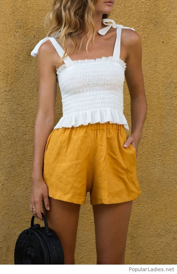 White tank and yellow shorts