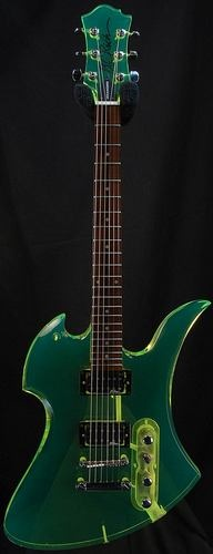 """B.C. Rich Mockingbird Clear Neon Green Acrylic  - Had to pass on it.  It's a heavy guitar at 16lbs.  Big concern with this model is with where the headstock is attached to the neck.  There is a youtube video of a guy who bought one with this kind of a break as a """"project guitar"""" detailing the fix.  Just can't take a chance on that...(sigh) :("""
