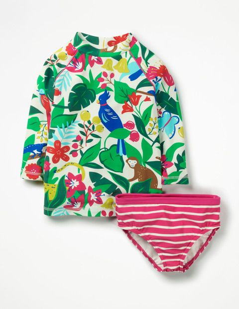 Grab that boogie board, it's time to ride those waves. The eye-popping print and contrasting piping on our surfsuit top will have pro surfers turning green with envy. Three-quarter length sleeves and a mock turtle neck keep the ocean chill out. We've swapped the shorts for bikini bottoms for extra flexibility.