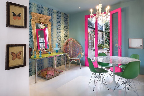 These hot pink door frames really add a pop of color to this space! We love the creativity here!