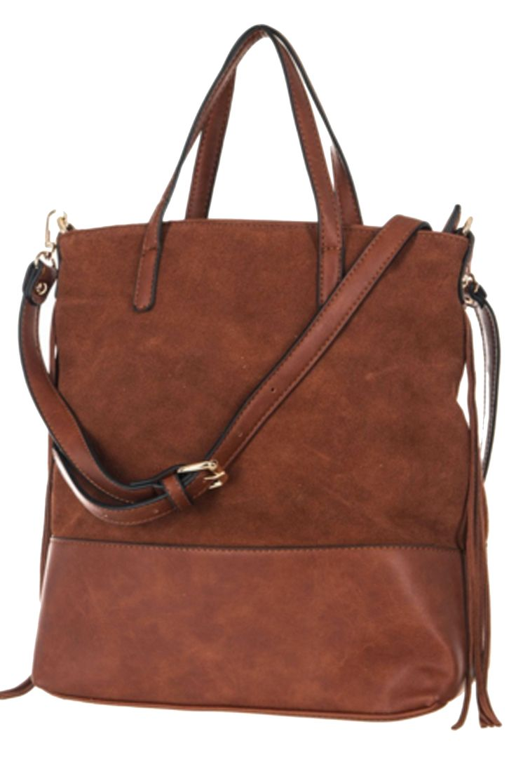 'Roads To St. Augustine' Tote Bag - A combination genuine leather and suede tote bag that can fit just about everything in it! This carry-all bag has a zipper fringe closure and has two compartments and a zippered pocket. Adjustable straps allow you to easily carry it across your boulder or over your shoulder so you can hit the all the roads that lead the oldest city in Florida for some vacation time! Available in Brown. Dimensions - 13 (H) x 11.5 (L) x 5 (W).