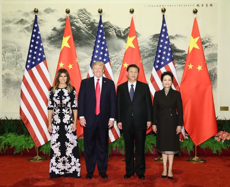 BEIJING, Nov. 9, 2017 -- Chinese President Xi Jinping (2nd R) and his wife Peng Liyuan (1st R), and U.S. President Donald Trump (2nd L) and his wife Melania Trump pose for group photos at the Great Hall of the People in Beijing, capital of China, Nov. 9, 2017.