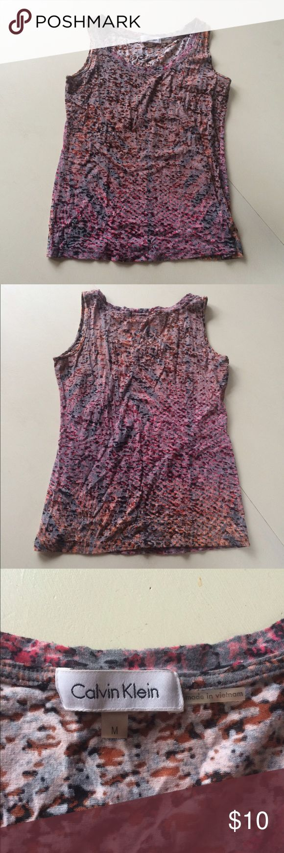 "Calvin Klein tank top shirt pink burn out M This is a lovely tank top by Calvin Klein. It is a gorgeous mix of pinks, oranges, and grays in a burn out fabric. Size M. Crewneck and no sleeves. Arm pit to arm pit: 15.5""-22"" Waist: 14""-18"" Arm pit to hem: 16"" Calvin Klein Tops Tank Tops"