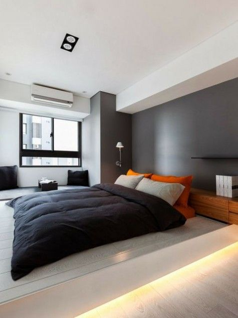 The Little White Apartment by Z-AXIS DESIGN - Design Milk I like the modern  look of this bedroom, especially the rich gray wall color with the bright  orange ...