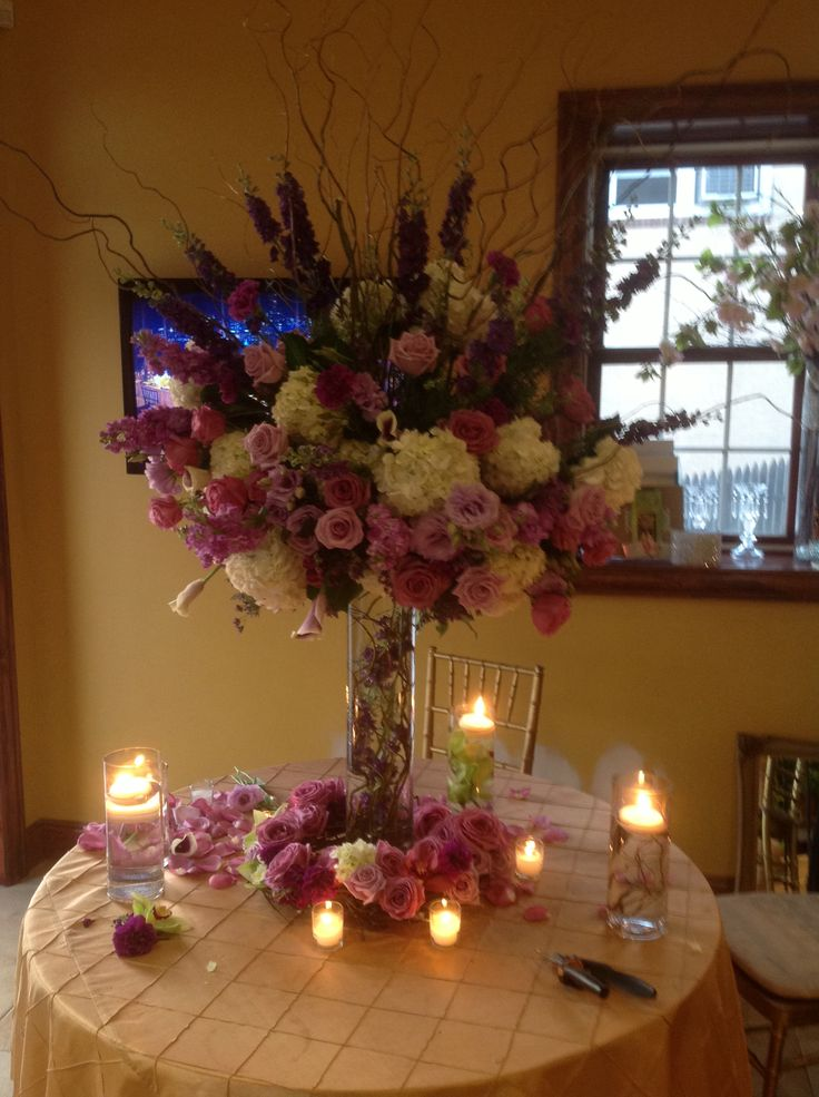 Wedding centerpiece of purple larkspur white hydrangea