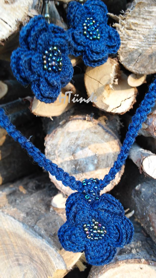 Crocheted dark bue set of earrings and necklace embelished with beads.