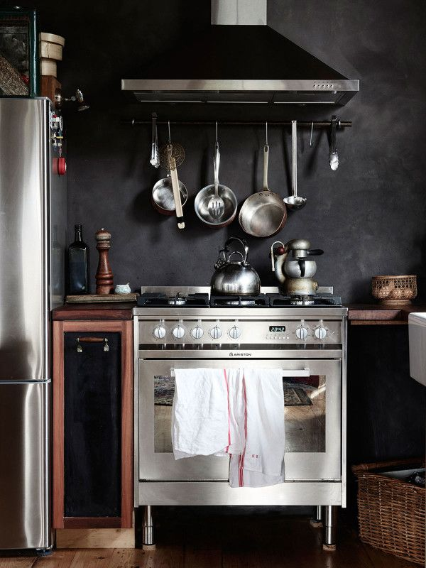 Kitchen details. Black oxide rendered feature wall behind stove, and egg basket found at an antique market in Burma. Photo – Eve Wilson. Production – Lucy Feagins / The Design Files.