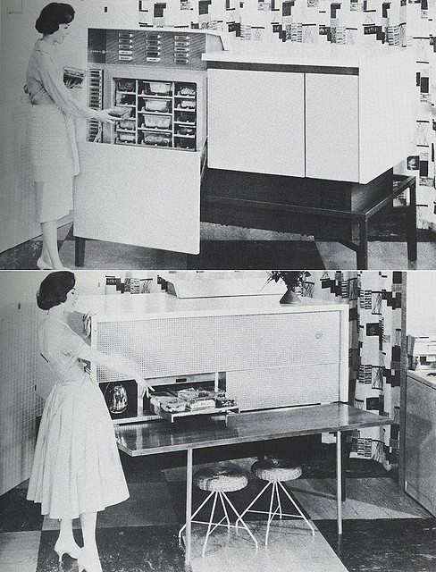 """Push a Button, Get a Meal. Among tomorrow's """"wife-savers"""" is this working model of a combination electronic oven and food freezer. Meals are prepared in advance and stored in the individual freezer compartments, each one labeled on the corresponding push buttons. At dinner time, the housewife pushes the appropriate buttons; and in less than half an hour, the full meal emerges at the rear end of the appliance, hot and ready to serve (lower picture)."""