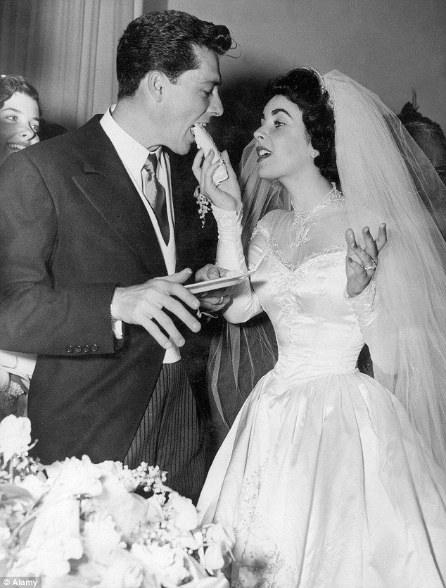 Elizabeth Taylor and Conrad Hilton eat cake at their 1950 wedding... and were divorced just eight months later