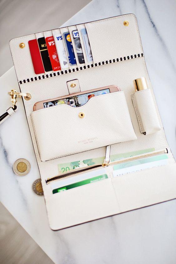 This wallet fits everything! Henri Bendel WRISTLET STRAP EYELET DETAIL