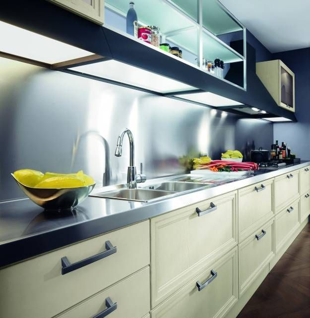 Stainless steel kitchen countertop ideas are stylish and popular. Lushome increases its collection of contemporary kitchen design ideas with photographs of modern kitchens that demonstrate the elegance of stainless steel kitchen countertop ideas.    Stainless steel countertop design is fresh and pra