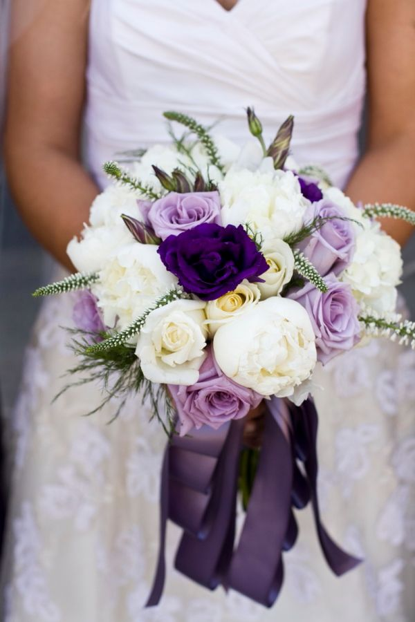 Lovely ivory, purple and lavender bouquet with cascading ribbon.