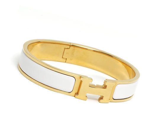 "Clic H Hermes narrow bracelet. White enamel. Gold plated hardware, 2.5"" diameter, 8"" circumference, 0.5"" wide"