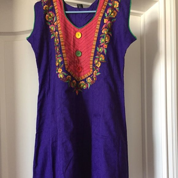 """Lightly embroidered blue tunic Beautiful colored light embroidery in front. Size XL Chest 40"""" Length 42"""" Not a Free People brand but listed as that for more views. Free People Tops Tunics"""