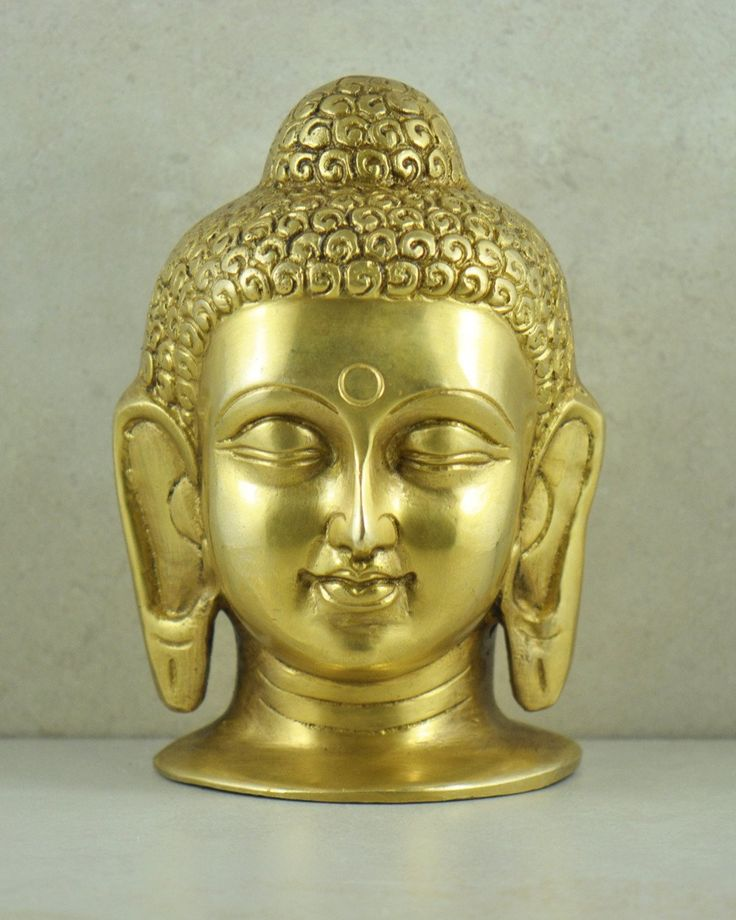 Large Brass Buddha in Meditation Head Statue. • Lord Buddha is one of the most important spiritual teachers in history. • He is considered a great master of meditation and of victory over self. • Through his great spiritual strength he attained enlightenment and his teaching dispersed into the world. • This is our large Buddha statue depicted in meditation with a peaceful smile and serene expression. • Portrayed with long ears signifying immense wealth he had during his life as a prince...