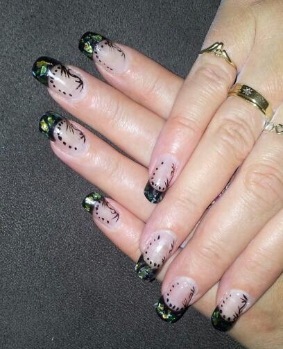 black acrylic tips with mylar paper and hand painted designs