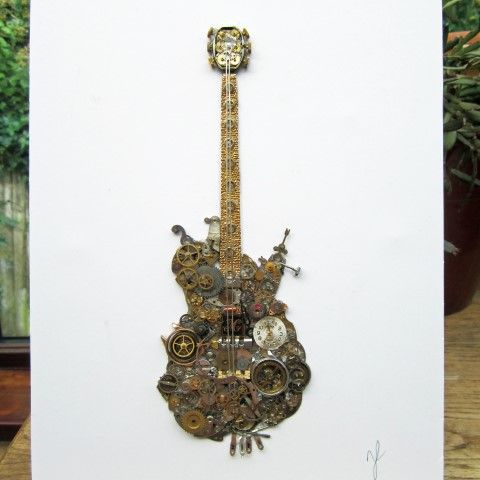 Guitar picture made from old watch parts