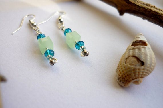Light coming through the beads of this pair of earrings makes them sparkle and underlines the character of their colour.  The colour blue recalls trust, honesty and loyalty. It is sincere, reserved and quiet, and doesn't like to make a fuss or draw attention.   This color exhibits an inner security and confidence. Who loves this colour seeks peace and tranquility above everything else, since it promotes both physical and mental relaxation.