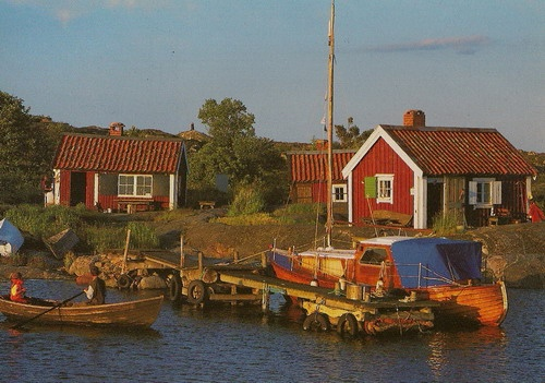 Water side small cottages in Sweden with boats