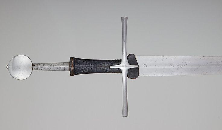 Date: 15th century  Culture: European  Steel, Leather, Wood  Dimensions: L. 48 3/8 in. (122.9 cm); L. of blade, 36 7/8 in. (93.7 cm); Wt. 3 lb. 9 oz. (1618 g)  Read more: http://sword-site.com/thread/724/oakeshott-xviiia-probably-central-european#ixzz3YnSmmtZp