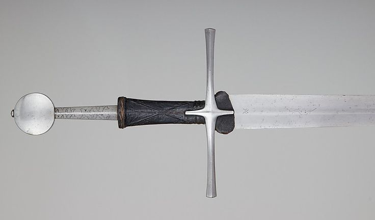 Date: 15th century  Culture: European  Steel, Leather, Wood  Dimensions: L. 48 3/8 in. (122.9 cm); L. of blade, 36 7/8 in. (93.7 cm); Wt. 3 lb. 9 oz. (1618 g)  Read more: http://sword-site.com/thread/724/oakeshott-xviiia-probably-central-european#ixzz3YnSmmtZp