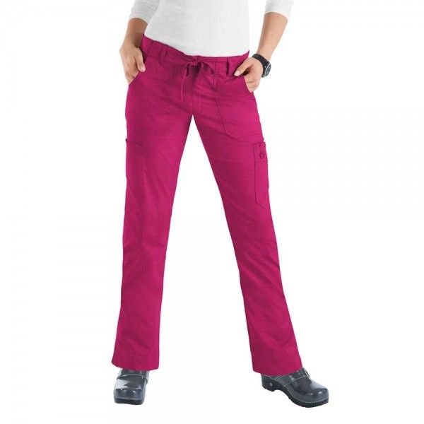 Lipstick Koi Stretch Lindsey Trousers in Lipstick. Do you like a more figure hugging scrub trouser leg? then the koi Stretch Lindsey Scrub Trousers are perfect for you. These slim fitting scrub trousers are figure flattering but with an extra stretch for comfort. £29.99 #nursescrubs #dentistscrubs #nurses #dentists #pinkscrubs #nurseuniform