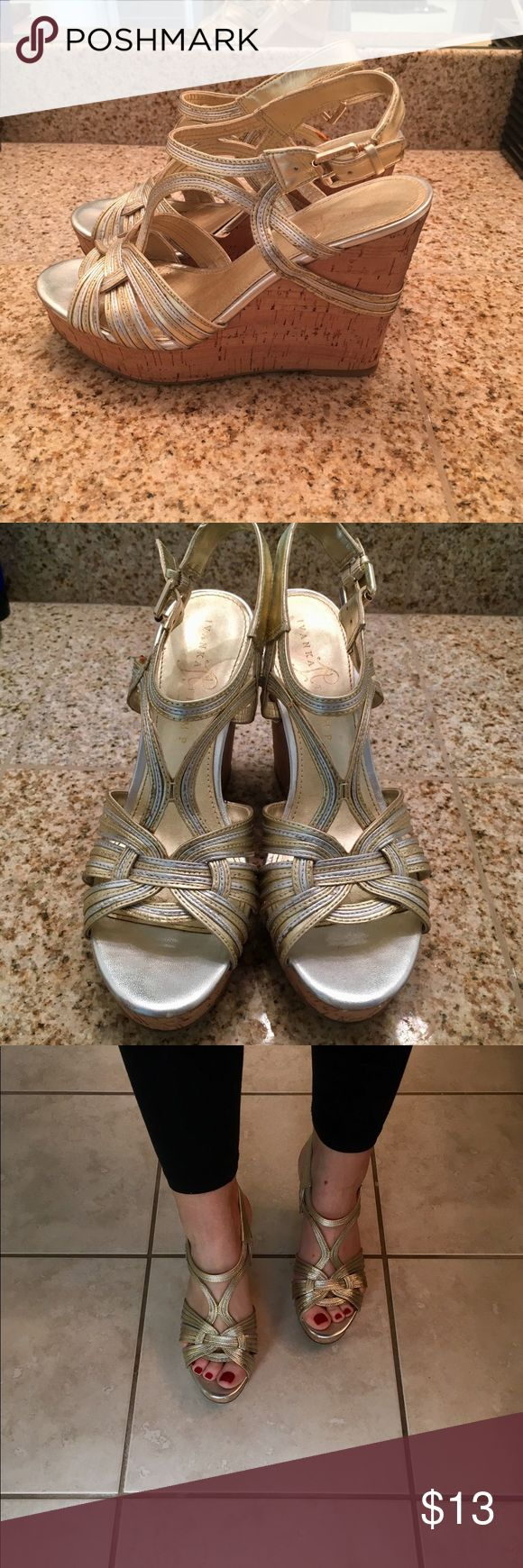 """Metallic gold & silver Ivanka Trump wedge sandals Metallic gold & silver wedge sandals by Ivanka Trump. Approx. 4"""" cork wedge with 1.5"""" platform. Very comfy and easy to walk in. Ivanka Trump Shoes Wedges"""
